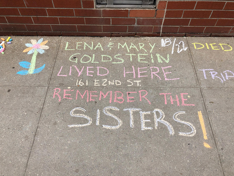 Lisa Goldstein chalks for sisters Lena + Mary Goldstein